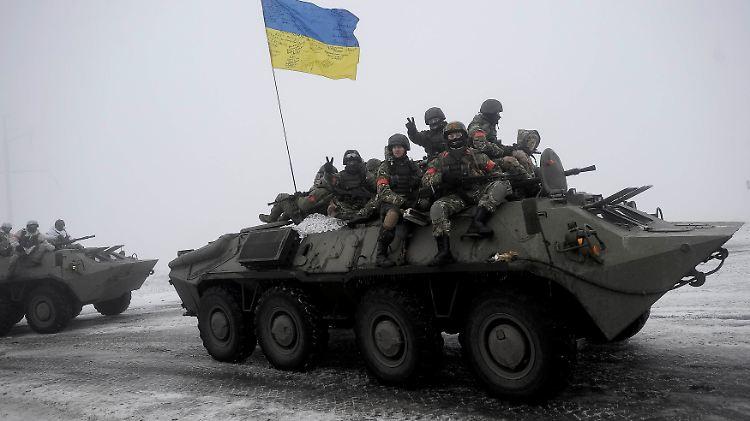2015-01-28T165710Z_908305192_GM1EB1T02KA01_RTRMADP_3_UKRAINE-CRISIS-RUSSIA-SHELLING.JPG8161832263764778227.jpg
