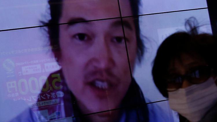 2015-02-01T053914Z_1505507570_GM1EB2111TB01_RTRMADP_3_MIDEAST-CRISIS-JAPAN-HOSTAGE.JPG6380076358608388392.jpg