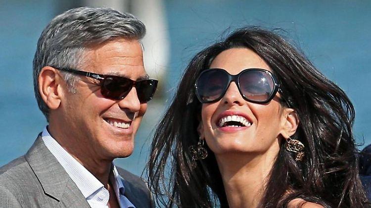 Glücklich ohne Kinder: Amal und George Clooney. Foto: Alessandro Di Meo