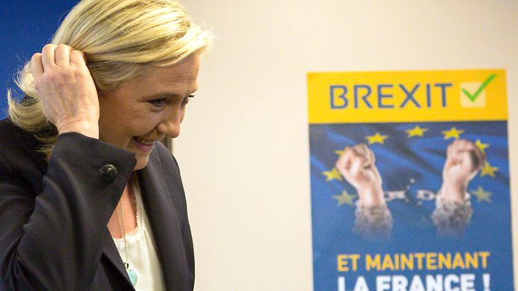 French far-right leader Marine Le Pen arrives for a press conference at the National Front party headquarters in Nanterre, outside Paris, Friday, June 24, 2016. Le Pen says pro-independence movements in the European Parliament will meet soon to plan their next move after the British vote to leave the European Union. Poster behind reads:  Brexit. And now, France.  (AP Photo/Kamil Zihnioglu)