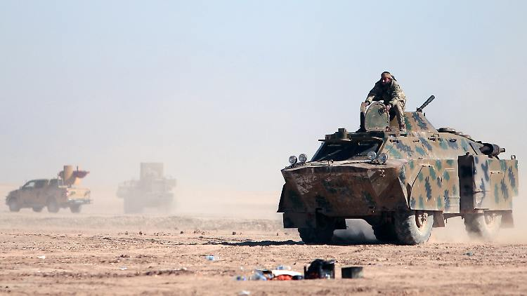 A Syrian Democratic Forces (SDF) fighters sits on a vehicle in the north of Raqqa city, Syria February 3, 2017. Picture taken February 3,2017. REUTERS/Rodi Said
