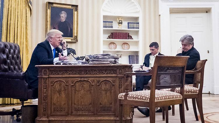 January 28, 2017 - Washington, District of Columbia, United States of America - National Security Advisor Michael Flynn and Senior Counselor to the President Steve Bannon, sit nearby as United States President Donald Trump speaks on the phone with Prime Minister of Australia, Malcolm Turnbull in the Oval Office on January 28, 2017 in Washington, DC, The call was one of five calls with foreign leaders scheduled for Saturday. .Credit: / Pool via CNP Washington United States of America PUBLICATIONxINxGERxSUIxAUTxONLY - ZUMAs152 20170128_zaa_s152_025 Copyright: xPetexMarovichx  January 28 2017 Washington District of Columbia United States of America National Security Advisor Michael Flynn and Senior Counselor to The President Steve Bannon Sit nearby As United States President Donald Trump Speaks ON The Phone With Prime Ministers of Australia Malcolm Turnbull in The Oval Office ON January 28 2017 in Washington DC The Call what One of Five Calls With Foreign Leaders scheduled for Saturday Credit Pool Via CNP Washington United States of America PUBLICATIONxINxGERxSUIxAUTxONLY ZUMAs152 20170128_zaa_s152_025 Copyright xPetexMarovichx