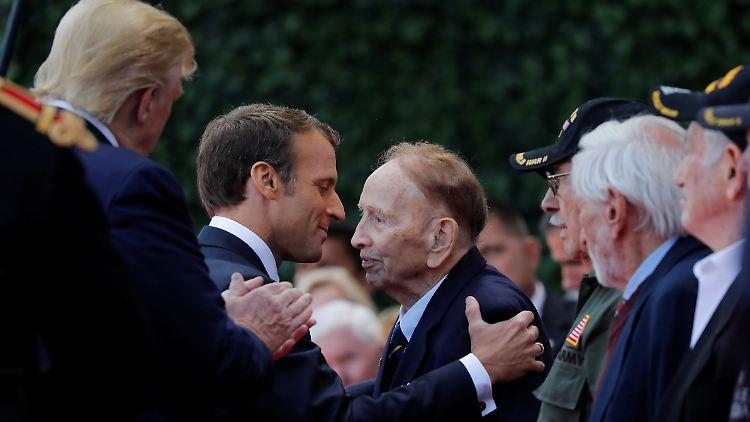 Macron und Trump bemühen sich an D-Day-Feier um Harmonie - International