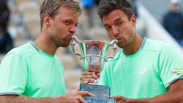 Kevin Krawietz und Andreas Mies (l-r). Foto: Pavel Golovkin/AP/Archivbild