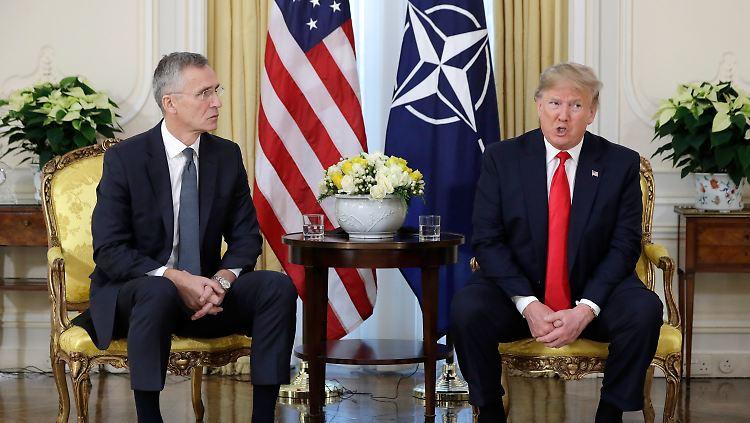 Treffen beim Nato-Gipfel :Merkel und Trump beschwören
