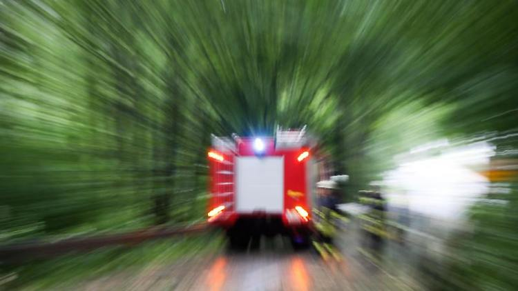 Ein Einsatzwagen der Feuerwehr. Foto: Friso Gentsch/dpa/Archivbild