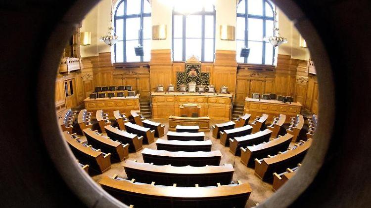 Der Plenarsaal der Hamburgischen Bürgerschaft. Foto: Christian Charisius/dpa/Archivbild