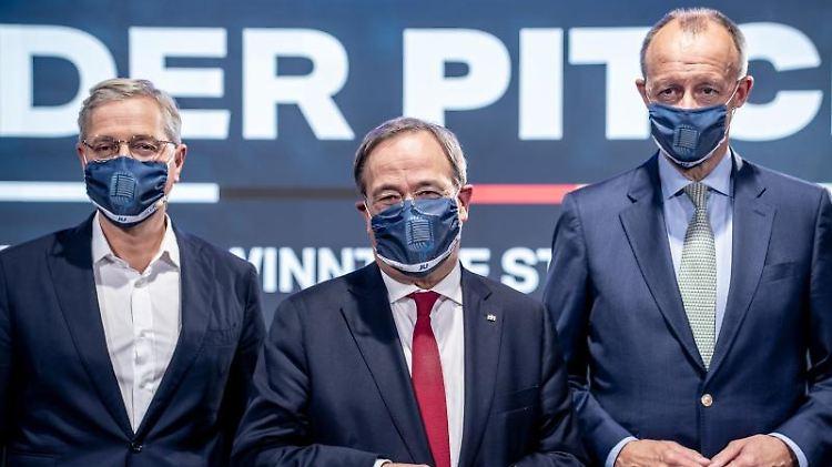 Die drei Kandidaten für den Bundesvorsitz der CDU, Armin Laschet (M), Friedrich Merz (r) und Norbert Röttgen (l).jpg