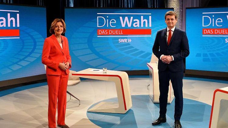 Ministerpräsidentin Malu Dreyer (SPD) und CDU-Spitzenkandidat Christian Baldauf beim TV-Duell. Foto: Kristina Schäfer/SWR/dpa