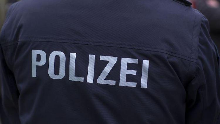 Polizist in Uniform. Foto: Jens Büttner/zb/dpa/Archivbild