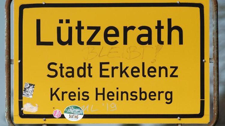 Das Ortsschild des Dorfes Lützerath, das zur StadtErkelenz gehört. Foto: Henning Kaiser/dpa/Archivbild