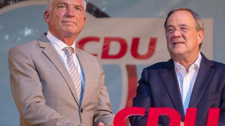 Thomas Strobl und Armin Laschet. Foto: Stefan Puchner/dpa